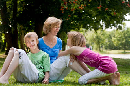Happy family enjoying their free time in the park photo