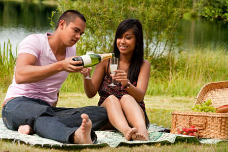 Young happy asian couple enjoying their time outdoors Stock Photo - 5441253