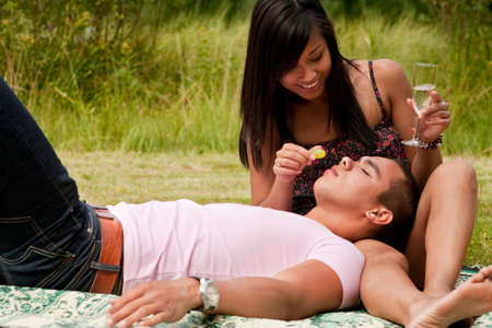 Young happy asian couple enjoying their time outdoors Stock Photo - 5441256