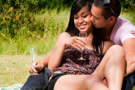 Young happy asian couple enjoying their time outdoors  Stock Photo