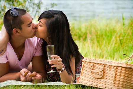 Young happy asian couple enjoying their time outdoors Stock Photo - 5441240