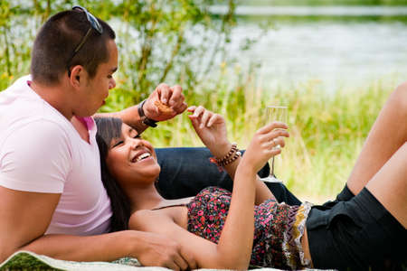 Young happy asian couple enjoying their time outdoors Stock Photo - 5441238