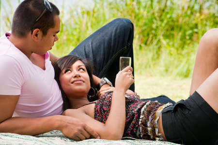 Young happy asian couple enjoying their time outdoors Stock Photo - 5441226