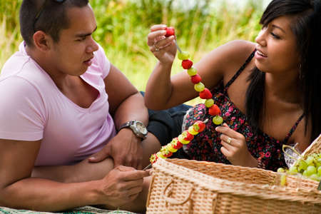 Young happy asian couple enjoying their time outdoors Stock Photo - 5441245