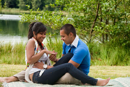 Young happy asian couple enjoying their time outdoors Stock Photo - 5441225