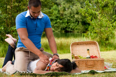 Young happy asian couple enjoying their time outdoors Stock Photo - 5441250