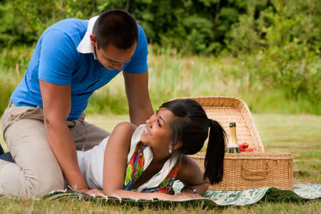 Young happy asian couple enjoying their time outdoors Stock Photo - 5441257