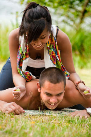 Young happy asian couple enjoying their time outdoors  photo