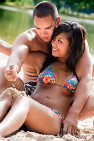 Young happy asian couple enjoying their time outdoors Stock Photo - 5441235