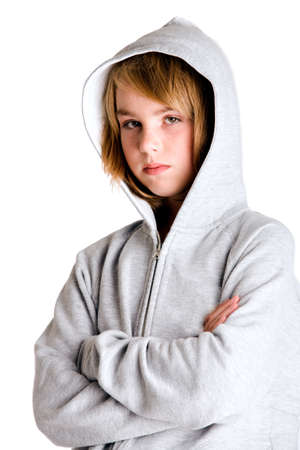 Girl in hooded sweater looking a little angry at you.  Made in a studio environment on white background