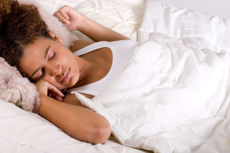 Cute african girl is falling a sleep in her bed photo