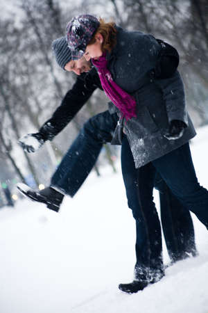 Happy couple in the snow having some fun together photo