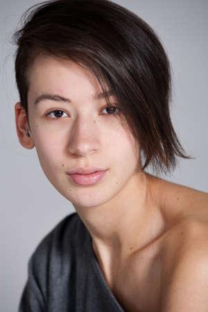 Natural studio portrait of multi etnic young woman photo