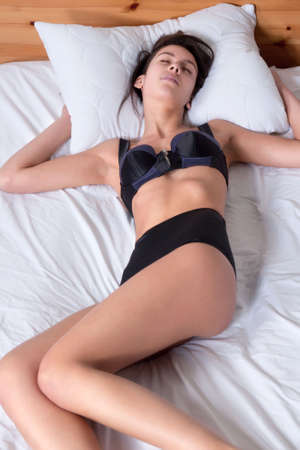 etnic: Young mult etnic woman lying and sleeping in bed Stock Photo