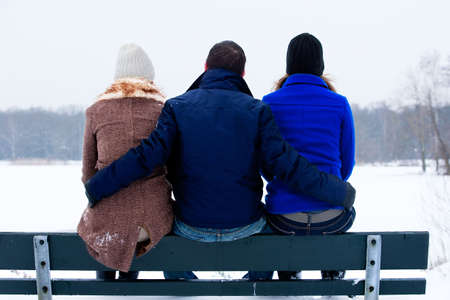 trio enjoying a wintery day in the park photo