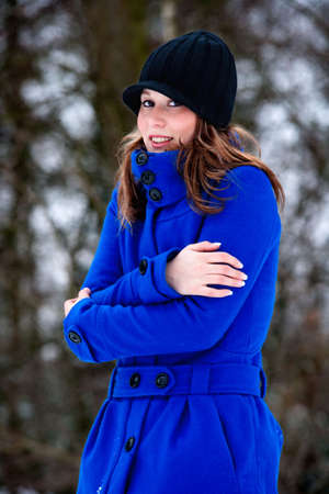 freezing cold girl in blue winter coat photo