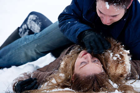 couple being passionate about eachother in winter photo