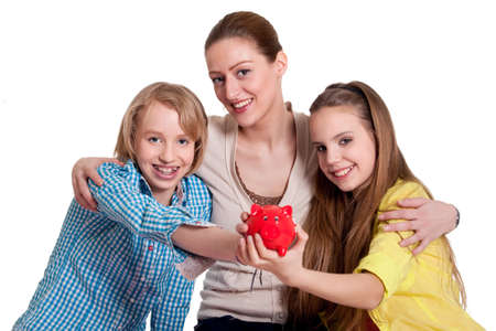 Mother and her children with a piggy bank photo