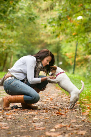 Happy girl with her Jack Russell Terrier Stock Photo - 8957001