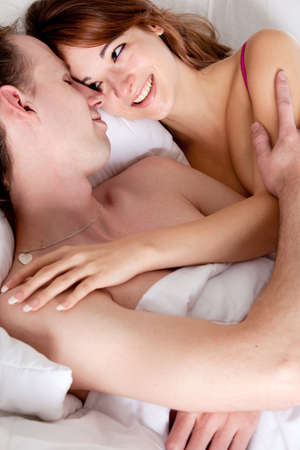 Young couple on a bed with emotions Stock Photo - 8957009
