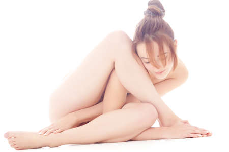 Naked gymnastic model making forms with her posture Stock Photo - 9116065