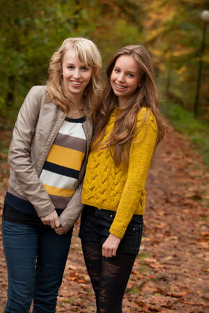 2 girls are having fun in the forest Stock Photo - 16640131