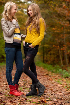 2 girls are having fun in the forest Stock Photo - 16640130
