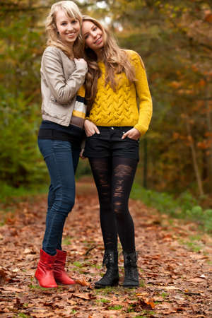 2 girls are having fun in the forest Stock Photo - 16640126
