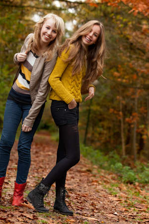 2 girls are having fun in the forest Stock Photo - 16669761