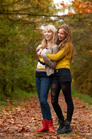 2 girls are having fun in the forest Stock Photo - 16640127
