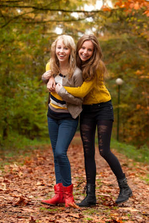 2 girls are having fun in the forest Stock Photo - 16640114