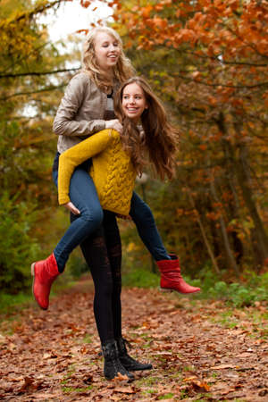 2 girls are having fun in the forest Stock Photo - 16640123