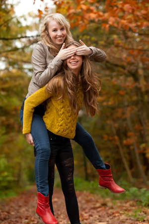 2 girls are having fun in the forest Stock Photo - 16669763