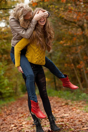 2 girls are having fun in the forest Stock Photo - 16640129