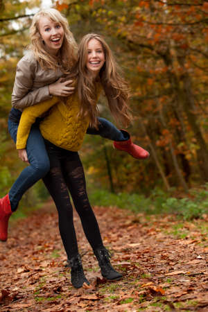 2 girls are having fun in the forest photo