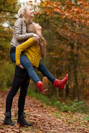 2 girls are having fun in the forest Stock Photo - 16669755