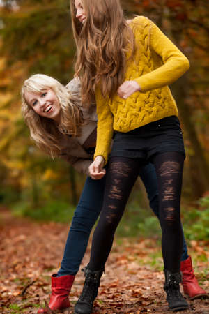 2 girls are having fun in the forest Stock Photo - 16640116