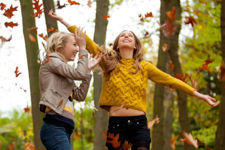 2 girls are having fun in the forest Stock Photo - 16639895