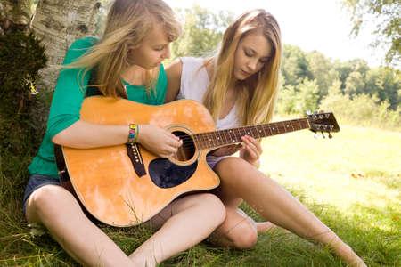 Two girls are having fun in the summer sun Stock Photo - 16637952