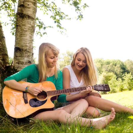 awe: Two girls are having fun in the summer sun