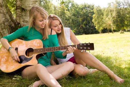 Two girls are having fun in the summer sun Stock Photo - 16637953