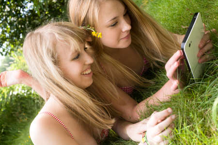Two girls are having fun in the summer sun photo