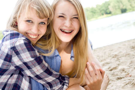 Two girls are having fun in the summer sun Stock Photo - 16669750