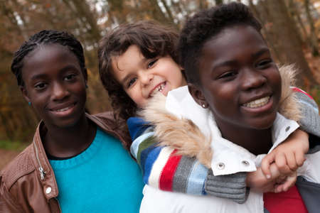 Happy foster children in the forest are having fun Stock Photo - 16972221