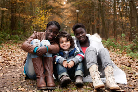 Happy family with foster children in the forest Stock Photo - 16972220