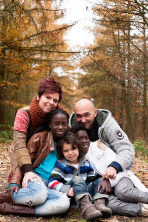 multicultural: Happy family with foster children in the forest Stock Photo