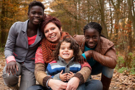 Happy family with foster children in the forest Stock Photo - 16972202