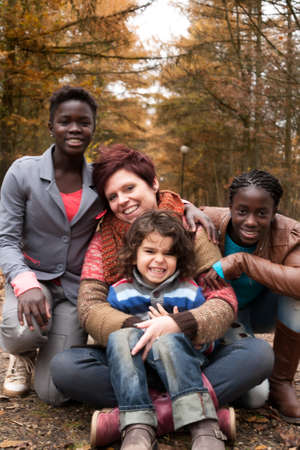 foster: Happy family with foster children in the forest Stock Photo