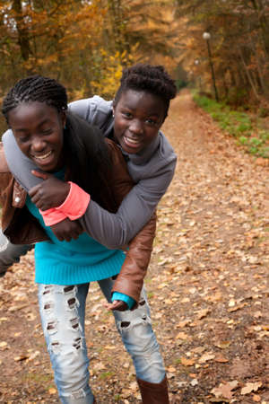 Happy foster children in the forest are having fun Stock Photo - 16972193