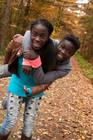 Happy foster children in the forest are having fun photo